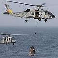 A Sh-60j Seahawk Transfers Cargo by Gert Kromhout