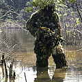 A Sniper Dressed In A Ghillie Suit by Stocktrek Images