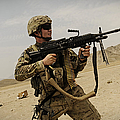 A Soldier Firing His Mk-48 Machine Gun by Stocktrek Images