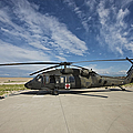 A Uh-60l Blackhawk Parked On Its Pad by Terry Moore
