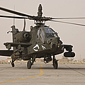 An Ah-64 Apache Helicopter Taxiing by Terry Moore