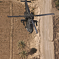 An Ah-64d Apache Helicopter In Flight by Terry Moore