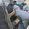 An Ak-47 Rests On The Sling Of An by Terry Moore