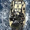An Amphibious Assault Vehicle Navigates by Stocktrek Images