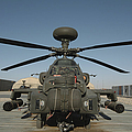 An Apache Helicopter At Camp Bastion by Andrew Chittock
