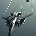 An F-15e Strike Eagle Flies Over Iraq by Stocktrek Images