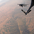 An F-15e Strike Eagle Is Refueled by Stocktrek Images