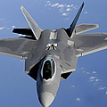 An F-22 Raptor Moves Into Position by Stocktrek Images