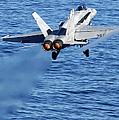An Fa-18c Hornet Taking Off by Stocktrek Images
