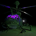 An Oh-58d Kiowa Helicopter At Cob by Terry Moore