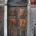 an old wooden door in Italy by Joana Kruse