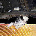 Astronaut Participates In A Spacewalk by Stocktrek Images