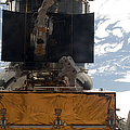 Astronauts Working On The Hubble Space by Stocktrek Images