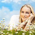 Beautiful Woman Enjoying Daisy Field And Blue Sky by Anna Om