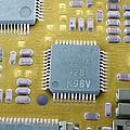 Circuit Board Microchip, Sem by Steve Gschmeissner