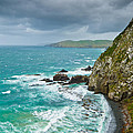 Cliffs Under Thunder Clouds And Turquoise Ocean by U Schade