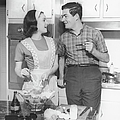 Couple Standing In Kitchen, Smiling, (b&w) by George Marks