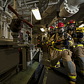 Firemen Combat A Simulated Fire Aboard by Stocktrek Images