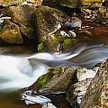 Flowing River Blurred Through Rocks by Simon Bratt Photography LRPS