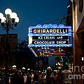 Ghirardelli Chocolate Signs At Night by Carol Ailles