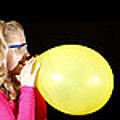Girl Bursting A Balloon by Ted Kinsman