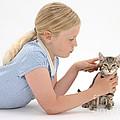 Girl Grooming Kitten by Mark Taylor