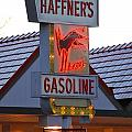 Kicking Haffner's Gasoline Sign by Mary McAvoy