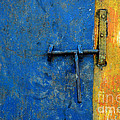 Latch The Door On The Faded Blue And Yellow Wall by Antoni Halim