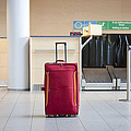 Luggage At An Airline Check-in Counter by Jaak Nilson