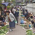 Morning Market In Luang Prabang by Roberto Morgenthaler