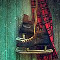 Old Ice Skates Hanging On Barn Wall by Sandra Cunningham