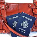 Passports With Orange Purse by Blink Images