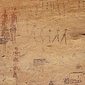 Pictograph Of Walking Figures by David Parker