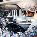 Rear-view Mirror by Photo Researchers