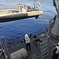 Sailors Lower A Rigid Hull Inflatable by Stocktrek Images