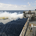 Sailors Observe A Mk-46 Recoverable by Stocktrek Images