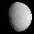Saturns Moon Dione by Stocktrek Images