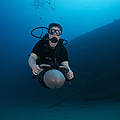 Scuba Diver Uses A Diver Propulsion by Terry Moore