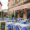 Sidewalk Cafe In Italy by Jack Schultz