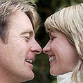 Smiling Couple Embracing by Ian Boddy