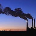 Smokestacks Billowing Smoke At Night by Skip Nall