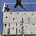 Soldier Rappels Off A Tower While by Stocktrek Images