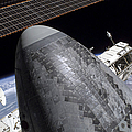 Space Shuttle Discovery Docked by Stocktrek Images