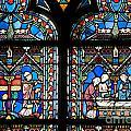 Stained Glass Window Of Notre Dame De Paris. France by Bernard Jaubert