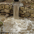 Storm Sewer Water Rushes Into A Stream by Joel Sartore