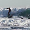 Surfers At Porthtowan Cornwall by Brian Roscorla
