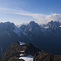 The Jagged Tops Of High Mountain Peaks by Taylor S. Kennedy