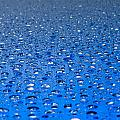 Water Drops On A Shiny Surface by U Schade