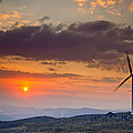 Wind Turbines At Sunset by Andre Goncalves