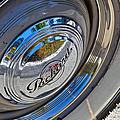 1940 Packard Hubcap by Bill Owen